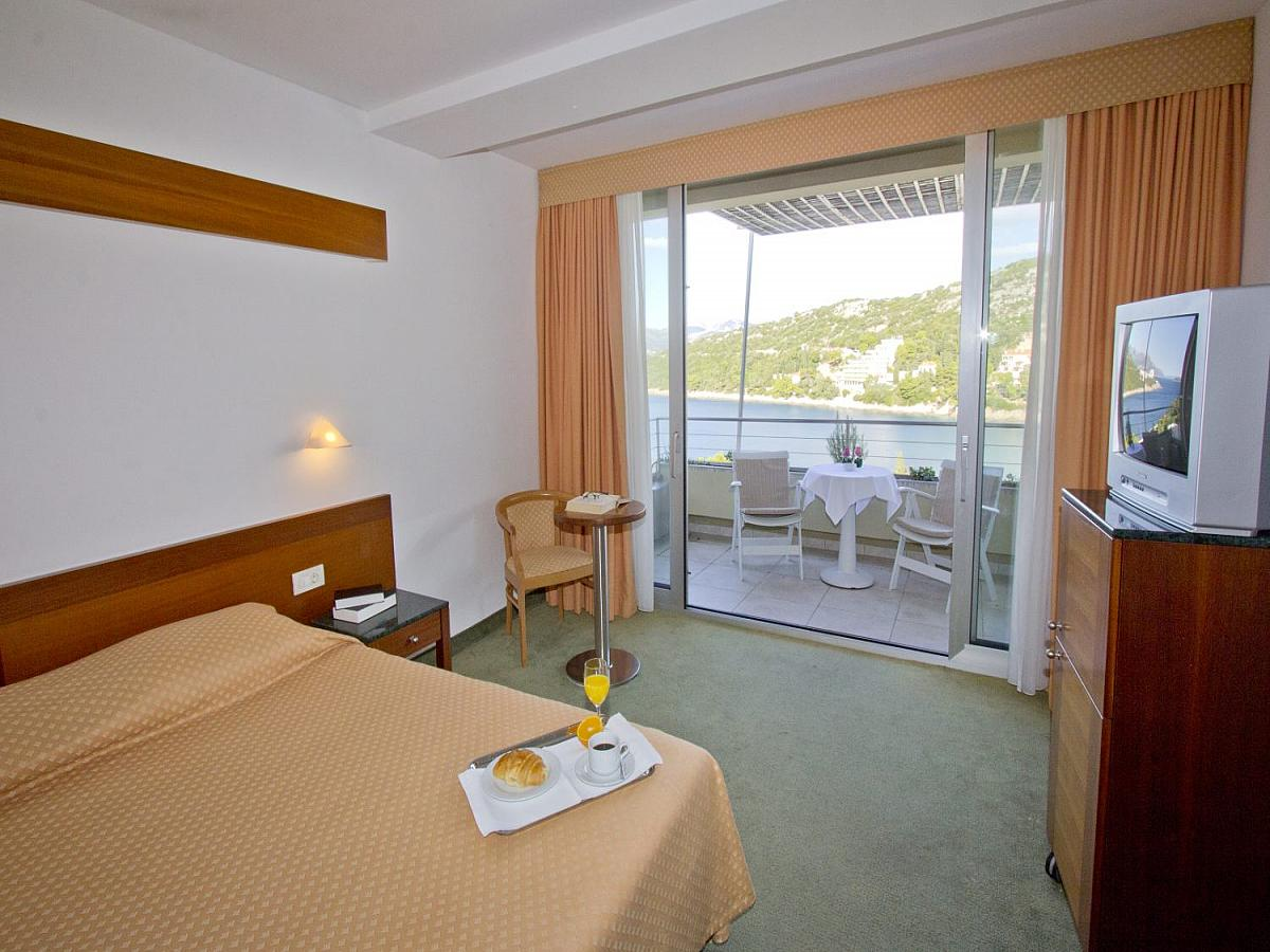 Double room sea side with balcony and half board