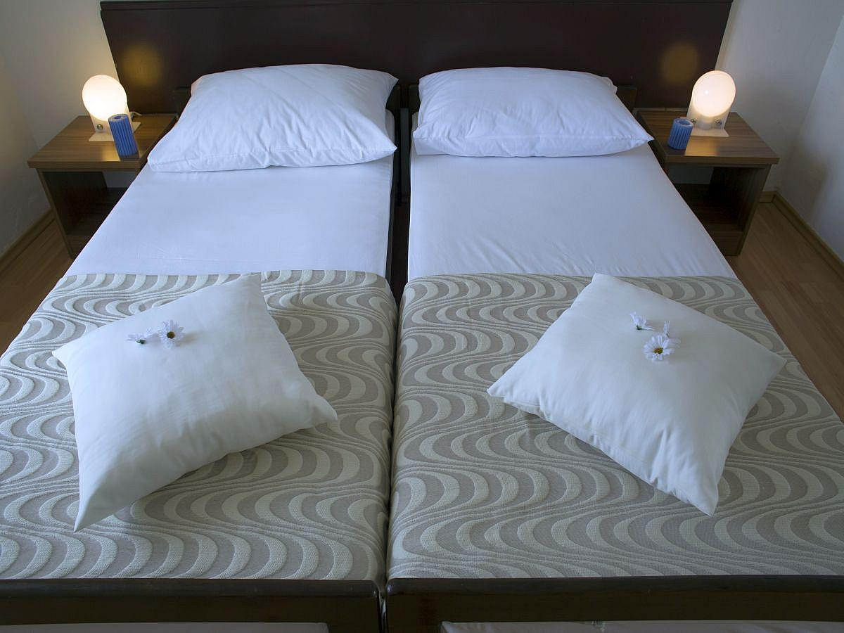 Double room sea side with extra bed, balcony, and half board