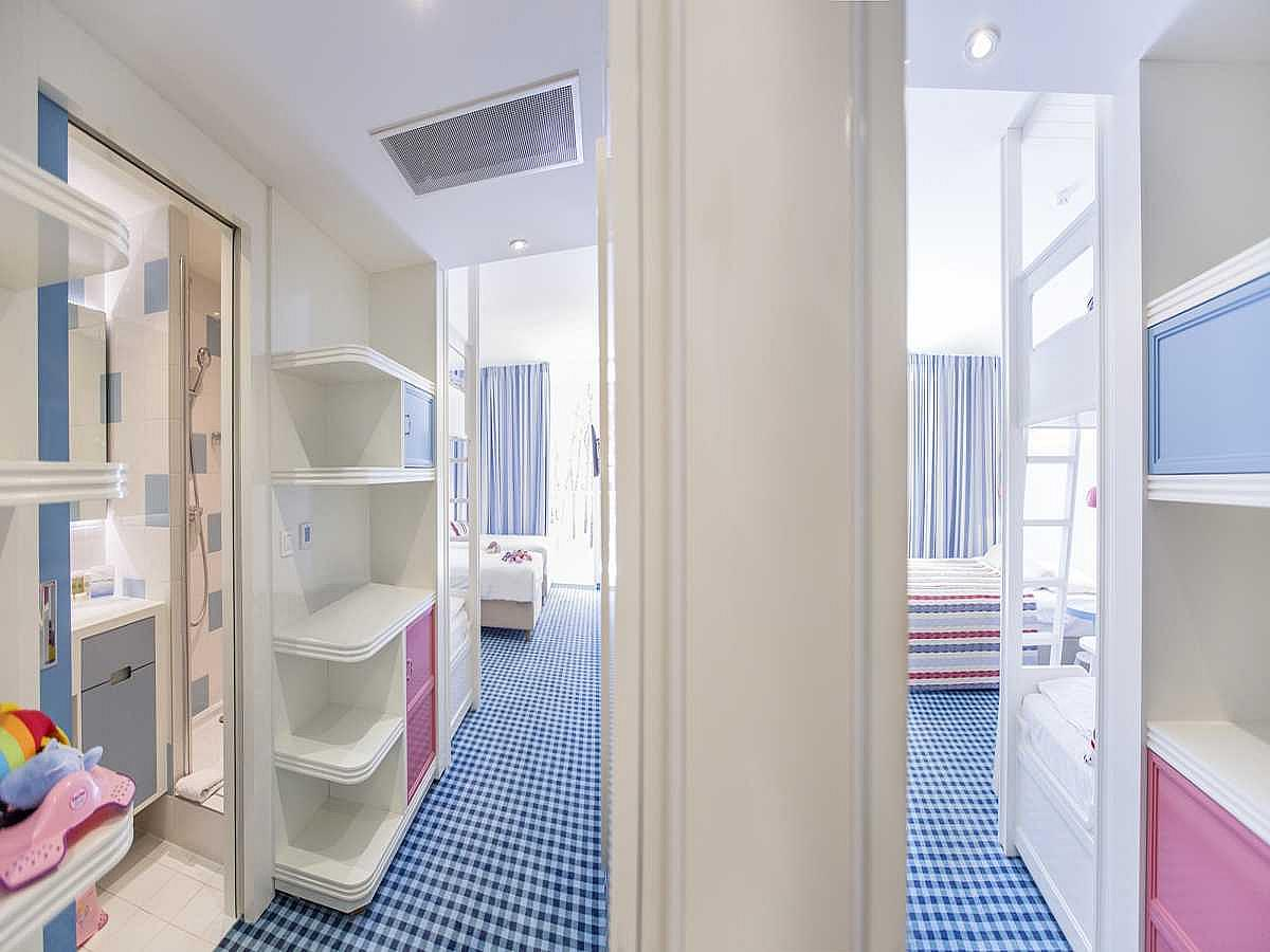 Two connected rooms with twin or double bed and two extra beds for children, balcony and park view with half board